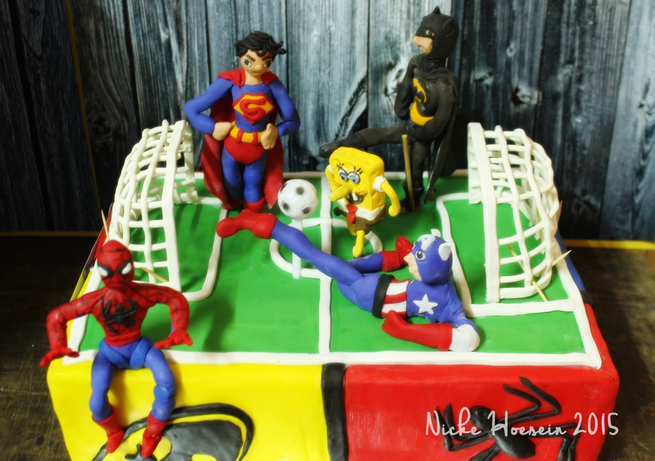 Super Heroes play Soccer Cake